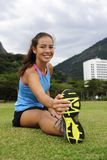 Sportive woman stretching in the park Royalty Free Stock Image