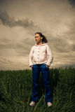 Sportive woman at wheat Stock Image