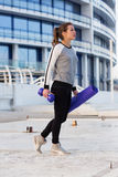 Sportive woman working out in the city Royalty Free Stock Photography