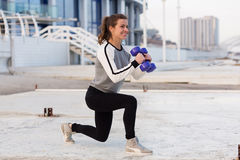Sportive woman working out in the city Stock Photo
