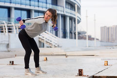 Sportive woman working out in the city Royalty Free Stock Photos