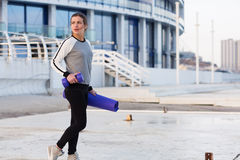 Sportive woman working out in the city Royalty Free Stock Photo
