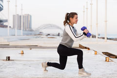 Sportive woman working out in the city Stock Image