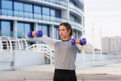 Sportive woman working out in the city Stock Photos