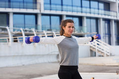 Sportive woman working out in the city Royalty Free Stock Image