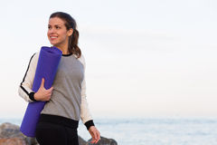 Sportive woman working out by the sea Royalty Free Stock Image