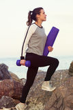 Sportive woman working out by the sea Stock Photo