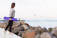 Sportive woman working out by the sea Royalty Free Stock Images