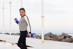 Sportive woman working out by the sea Royalty Free Stock Photo