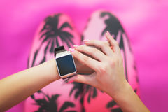 Sportive Woman After Workout Session Checking Fitness Results on Smart Watch. Young woman checking fitness progress Royalty Free Stock Photos