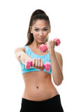 Sportive woman works out with dumbbells Stock Images
