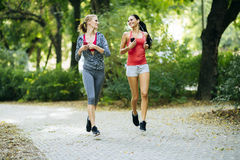 Sportive women jogging in park Royalty Free Stock Photography