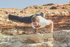 Sportive young man is doing yoga and pilates Stock Image