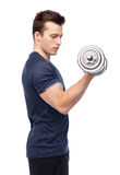 Sportive young man with dumbbell. Sport, fitness, exercising, healthy lifestyle and people concept - sportive young man with dumbbell flexing muscles Stock Photography