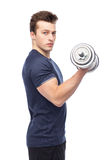 Sportive young man with dumbbell. Sport, fitness, exercising, healthy lifestyle and people concept - sportive young man with dumbbell flexing muscles Royalty Free Stock Image
