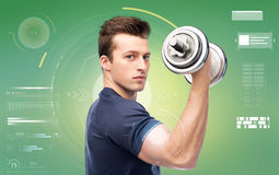 Sportive young man with dumbbell Stock Photos