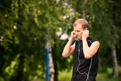 Sportive young man jogging outdoor Stock Images