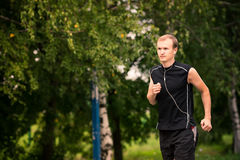 Sportive young man jogging outdoor Stock Photo
