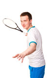Sportive young man playing tennis Stock Photos