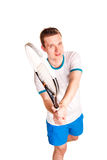 Sportive young man playing tennis Royalty Free Stock Image