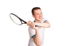 Sportive young man playing tennis Stock Photography