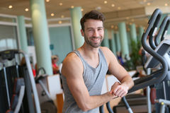 Sportive young man relaxing after working out in fitness club Stock Photo