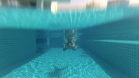 Sportive young man swimming breaststroke style in swimming pool, underwater view. Action camera. Sportive young man swimming breaststroke style in the swimming stock footage