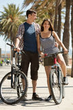 Sportive young people with bikes Royalty Free Stock Image