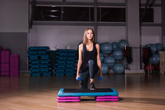 Sportive young woman with beautiful athletic body doing exercises with dumbbells. Fitness, bodybuilding. Healthcare Stock Images