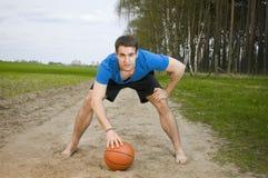 Sportivo con la palla Fotografia Stock