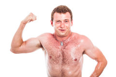 Sportivo divertente che mostra il bicipite Fotografie Stock Libere da Diritti