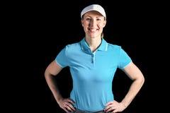 Sportlerin, die auf schwarzem Hintergrund aufwirft Lizenzfreie Stockbilder