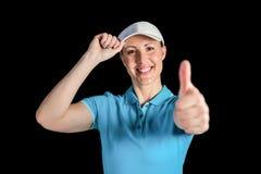 Sportlerin, die auf schwarzem Hintergrund aufwirft Lizenzfreies Stockbild
