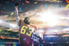 Sportlerspieler des amerikanischen Fu?balls auf Stadion in der Aktion stockbilder
