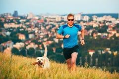 Sportlevensstijl met hond stock foto