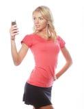 Sportliche blonde Frau, die selfie macht Lizenzfreie Stockbilder