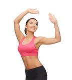 Sportliche Frau in der aerober oder Tanzbewegung Stockbilder