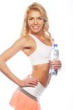 Sportliche Frau mit Wasserflasche Lizenzfreies Stockfoto