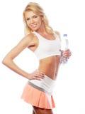 Sportliche Frau mit Wasserflasche Stockfoto