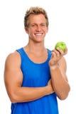 Sportlicher Mann mit Apfel Lizenzfreies Stockfoto
