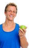 Sportlicher Mann mit Apfel Stockfotos