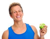 Sportlicher Mann mit Apfel Stockbild