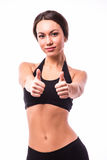 Sportly girl demonstrate okey gesture. On white Stock Image