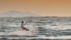Sportman play kite surf on Fabru Stock Photos