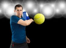 Sportman playing paddle with focuses Stock Photography