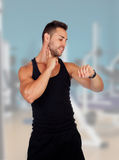 Sportman watching his pulse. Sport-man watching his pulse in the gym Stock Photography