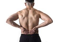 Sportmann des muskulösen Körpers, der die wunde Tiefrückseitentaille massiert mit seinen Handleidenden Schmerz hält Lizenzfreies Stockbild