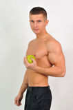 Sportmannen met een appel stock fotografie