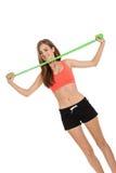 Sportowa młoda kobieta robi treningowi z physio taśmy lateksową taśmą fotografia stock