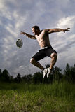 Sportowiec i zegar Zdjęcia Royalty Free